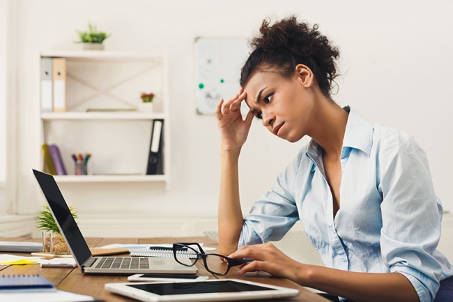 Frustrated woman at computer